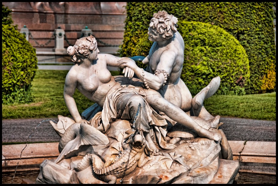 The fountain represents the Greek god Poseidon (God of the Sea) seducing Medusa in the temple of the goddess Athena. Medusa was the most beautiful woman in Athens before Poseidon raped her in the temple, enraging Athena who turned her into the hideous monster we know of in mythology. At the time, rape was not forgiven, and even though she was innocent, she still was punished.