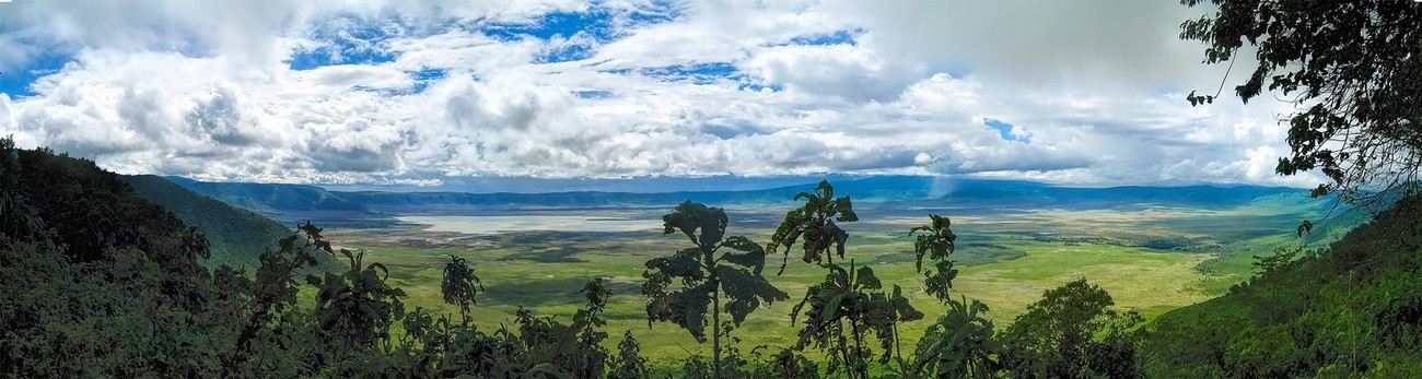 Panoramic view of the Ngorongoro Crater, Tanzania. The image captures the 20 km diameter of this caldera. A local rain shower is evident to the viewer's center right.