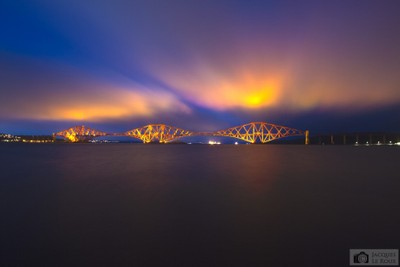 Forth railway bridge during misty blue hour