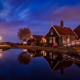 The house on the picture is part of the Zaanse Schans museum its a old fashioned cheese farm. Zaanse Schans is a neighbourhood of Zaandam, near Z...