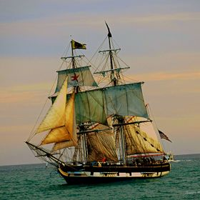 This picture was taken in Dana Point, California as the Tall Ships were sailing into harbor at sunset.  The name of the ship is The Pilgrim.