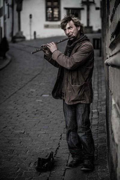 Street Flautist Along the Wall B&W