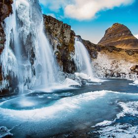 Partially frozen waterfall in Iceland