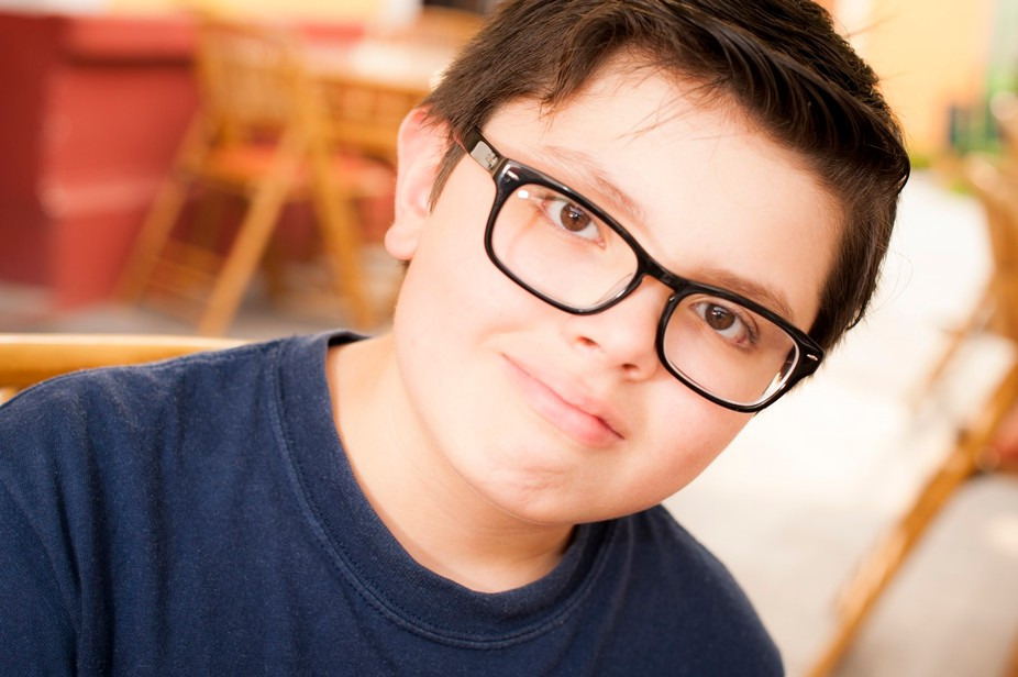 Portrait of my son, my favorite subject. Flash set as a remote in TTL mode, handheld off to camer...