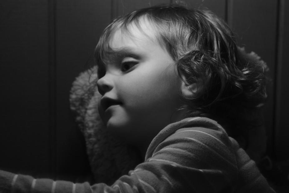 My daughter, resting on her teddy bear