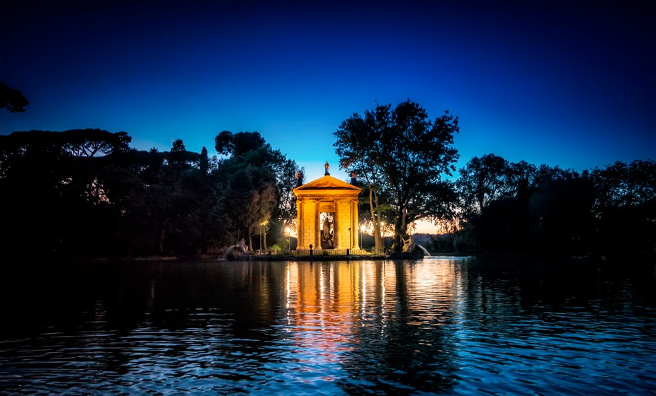 a bueatiful shot just after sunset of a temple in the parc of the villa borghese in rome