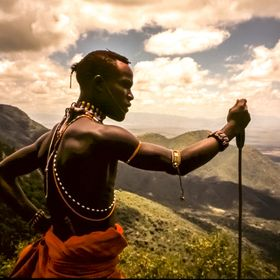 Maasai warrior on the edge of the escarpment in Kenya