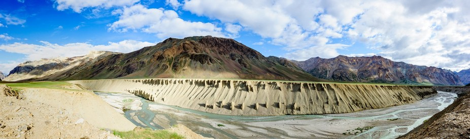 A panoramic view of the Tsarap River on the road going from Keylong to Leh. Near Hemis National P...