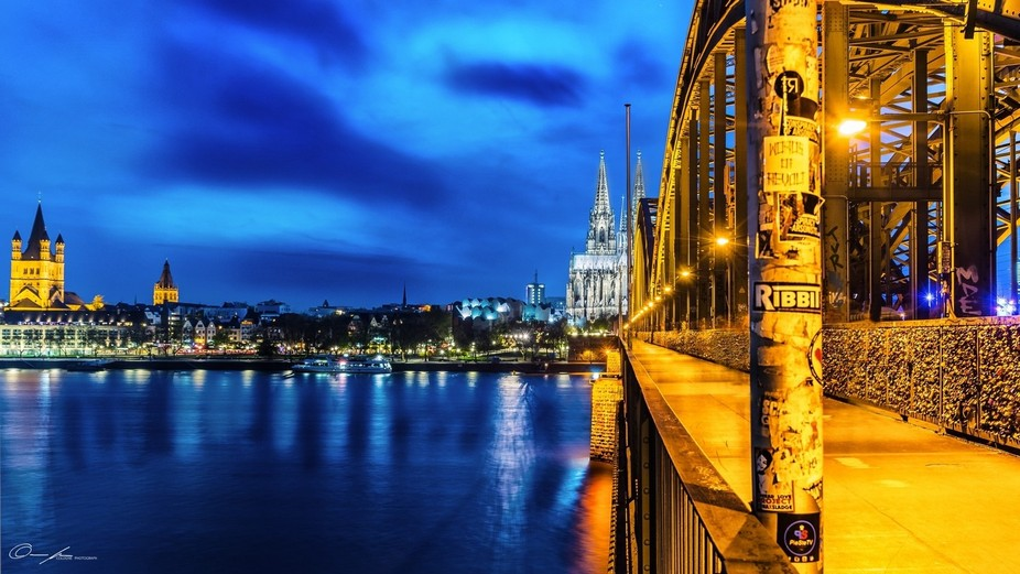 The Cologne Cathedral and the Hohenzollern Bridge at night - one of the famous motifs in Cologne....