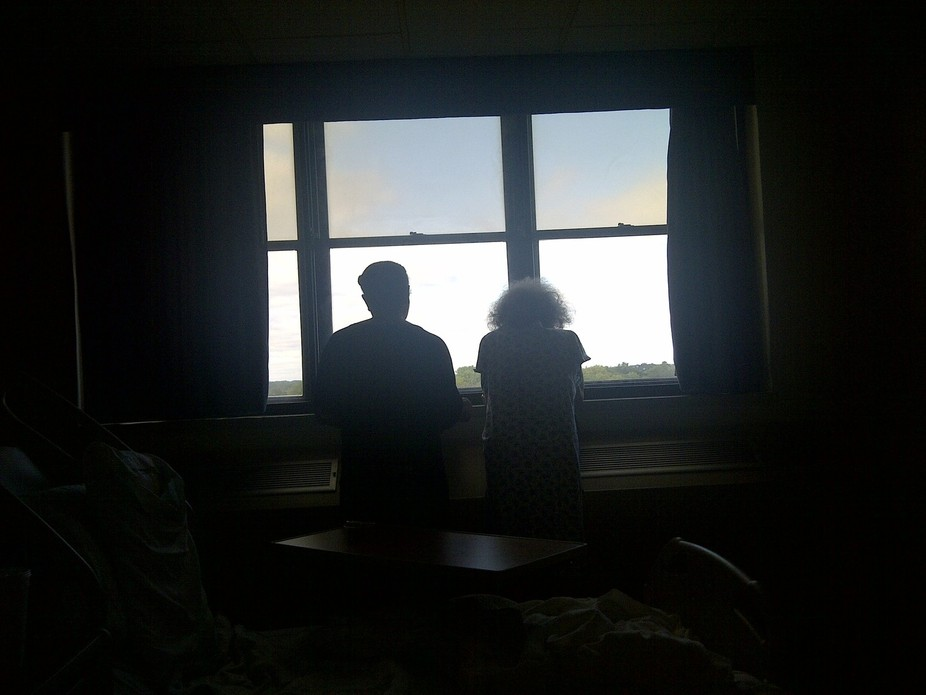 My dear aunt framed in the window as she appears to be underneath a cross. This was the last time...