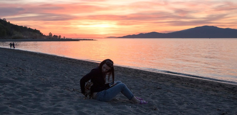 My Daughter Jen and Petron the Bengal cat enjoying the beach.  Jericho Beach, Vancouver, B.C. Can...