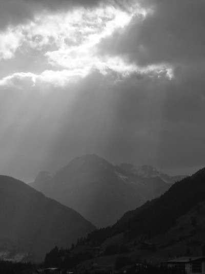 Sun breaking through the clouds in the mountains