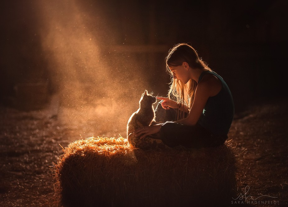 She has a magical way with animals. This was taken in our hayloft, where the light and dust creat...