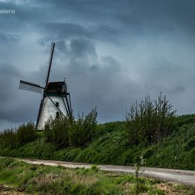 The Brouckmolen is a windmill in Beveren- to-the- Iron in the Belgian province of West Flanders . The mill is located near the Iron . It is a whi...