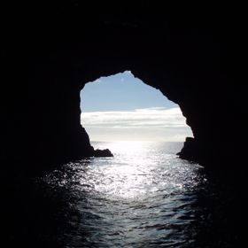 This image was taken at Hole in the Rock located at Piercy Island in the Bay of Islands, New Zealand. The shot is from a boat in the hole itself.