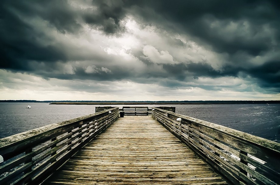 Dark clouds and pier