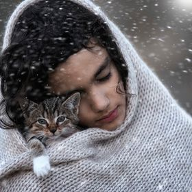 my son and our kitty ....it was cold outside ...so they warmed up each other....