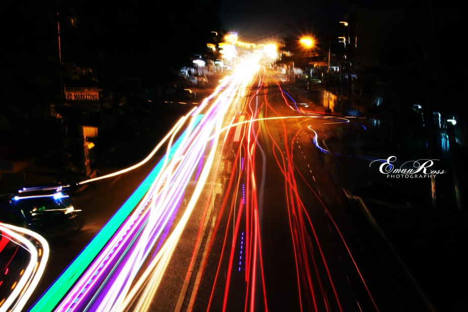Long exposed vehicle lights passing national road in Gingoog City, Misamis Oriental Philippines.