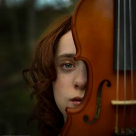 A portrait of a girl and her violin.