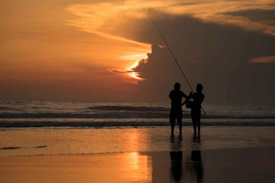 Balinese men fishing