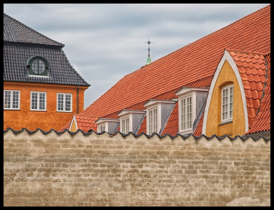 Turrets and Tiles make for an interesting Photograph, contrasting colours add a certain Drama to ...