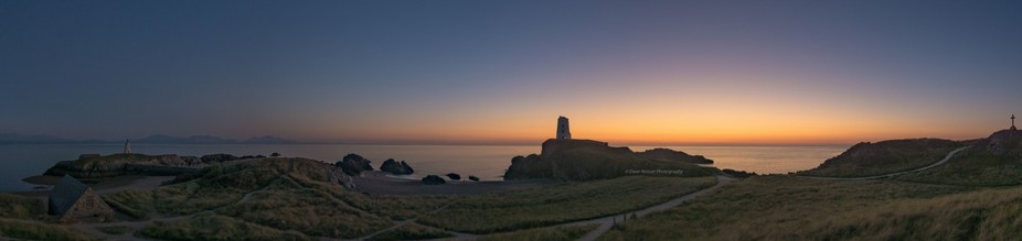 The sun sets on another day over the tidal island of Llanddwyn, Anglesey. This panoramic shot con...