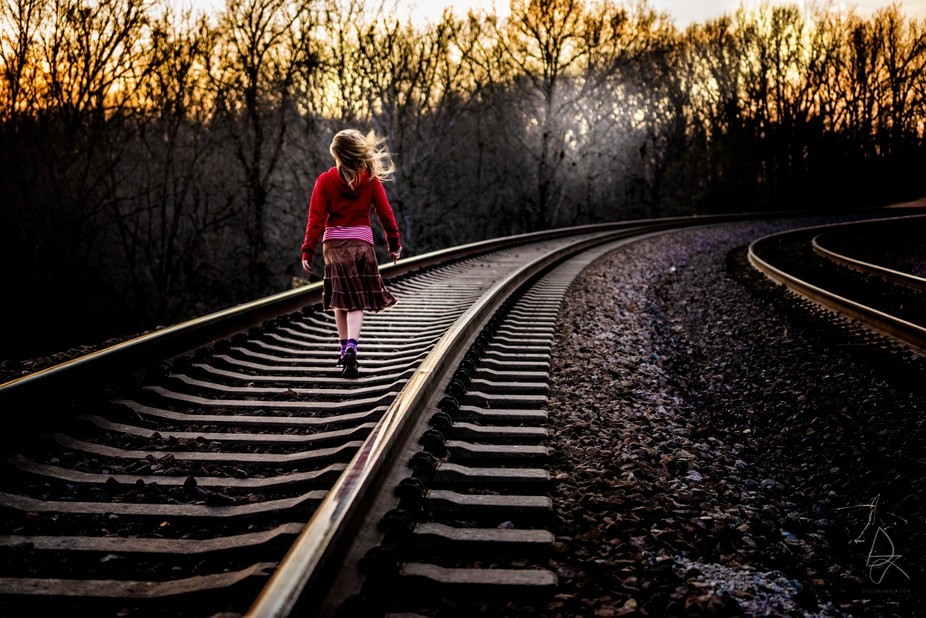 Train wails in the distance. She doesn't care. There are two tracks.