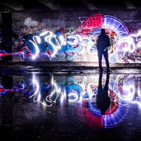Grafiti artist with his art. Light painting with flashlights to enhance the creativity. Gives the impresssion of seeing how art in the mind can i...