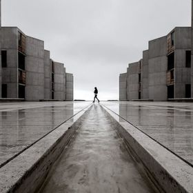 Small stream down the center of the Salk Institute. Woman walked by at just the right time.