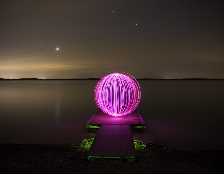 ball of light on the lake in the middle of the night. Welcome to the jetty.