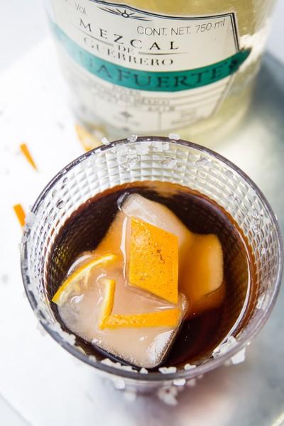 orange with mezcal cocktail