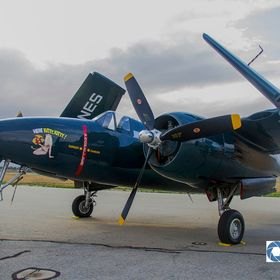 """Here Kitty Kitty"" Grumman F7F Tigercat ""Here Kitty Kitty"" sits in the early morning light waiting for day's activities..."