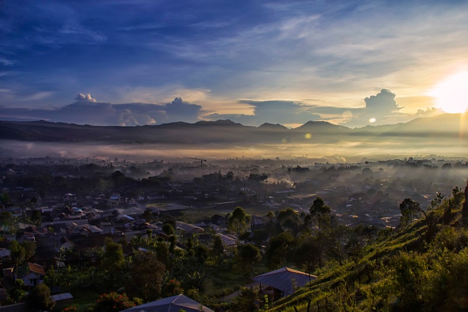early sunny morning, shrouded by fog and the effects of the morning sun, bringing passion to wor...