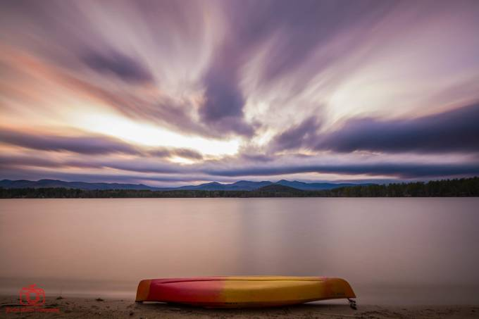 Kayak and Sunset by marlonmullon - Composing with Negative Space Photo Contest