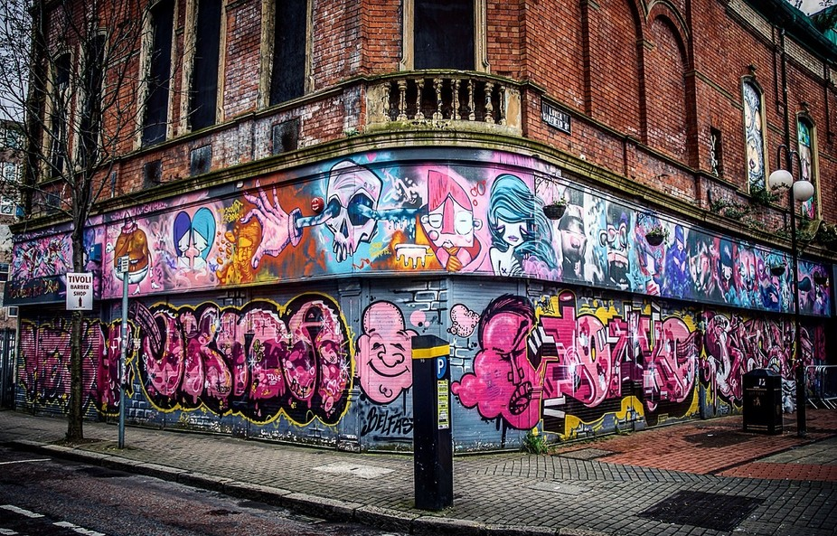 Shot by my father - Highland_r  Street art in this city is not simply a display of individual tal...