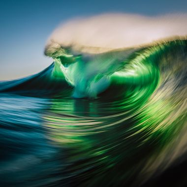 A creative speed blur of a moving wave in golden light.