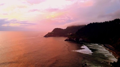Heceta Lighthouse in the Distant Sunset Glow