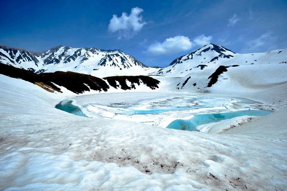 Snow Melts at Lake Mikurigaike at Murodo (Tateyama Alpine Route)