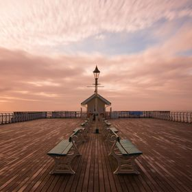 Spotted this beautiful pier next to the Penarth Bay in South Wales (thanks to google maps). It was start of the summer in UK and the sunrise was ...