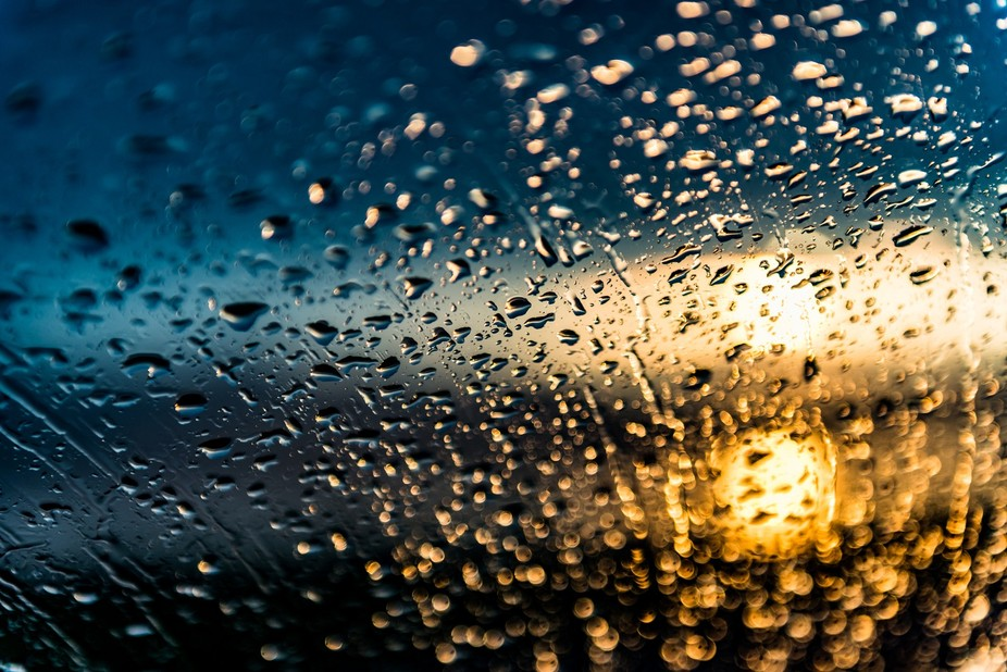 Rain on a windshield at sunrise.