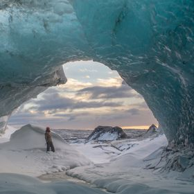 The surreal look from inside the blue-toned ice caves of the Jockusarlon glacier of southern Iceland. This shot was taken at Sunrise.