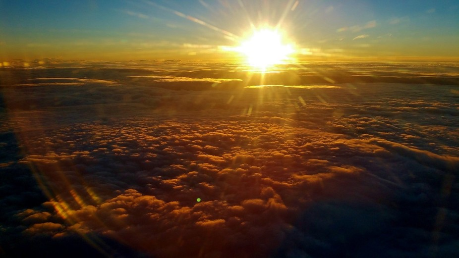 I've wanted for a very long time to get a picture of the clouds from an airplane. This d...