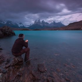 A warming light against the strong winds and gushes of glaciar waters of Lake Pehoe, Torres del Paine, Chile.