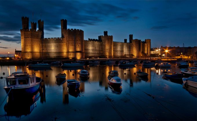 Sunset at Caernarfon castle by delhunter - Enchanted Castles Photo Contest