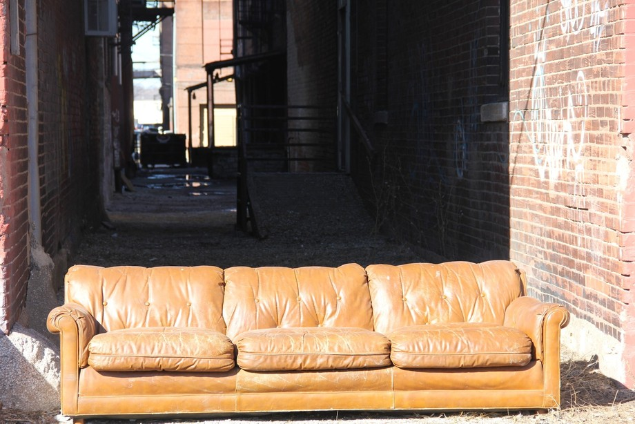 Sofa discarded in the alley. Taken while on a walking photo shoot in West Bottoms, Kansas City, MO.