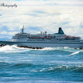 "Cruise Liner ""Albatross"" having to to carefully manoeuvre around a rocky outcrop to the harbour entrance"