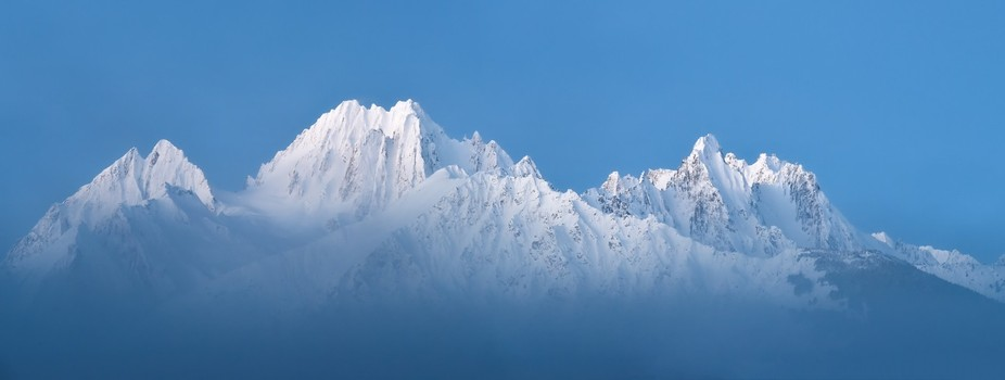 Chilkat  Mountains on a crisp winter morning. This image was taken during the blue hour, before s...