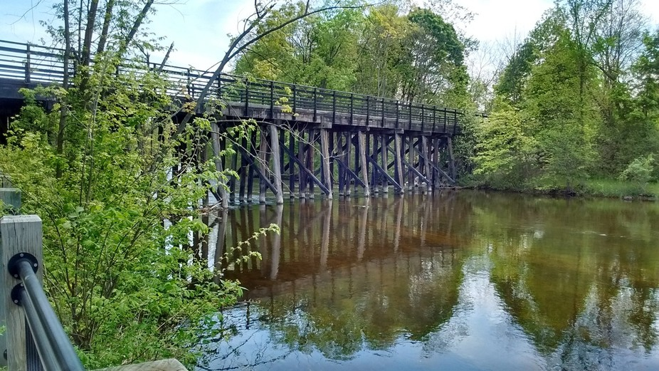 The rustic look of the bridge with the calm water makes for a very relaxing spot.