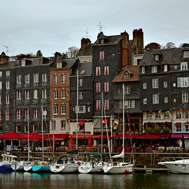 Honfleur looks so utterly enchanting, it is hard to remember that it was built essentially for commerce. Its harbor sits in a great location, tucked away on the southern side of the Seine's estuary. During the Hundred Years War, the French king had this strategic spot fortified, but that didn't stop the English taking over for several decades.   D810 with 24-120 f/4G ED VR lens at 65mm. 1/160, f/8 Auto ISO 100, Manual Mode. Processed in Capture NX-D and PSCS6 Extended using Picture Postcard workflow.