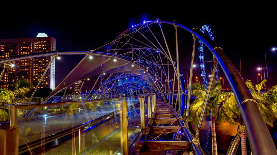 The Helix bridge at Marina Bay in Singapore is very appealing for photographers, it's cy...
